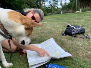 Sarah and dog map reading